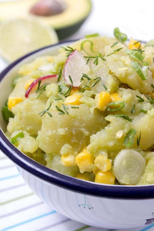 Avocado potato salad in a white bowl