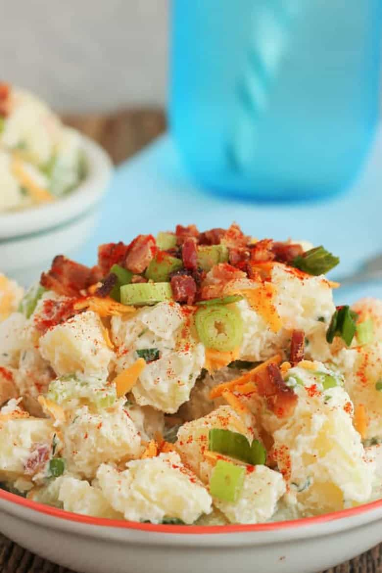 Loaded baked potato salad in a dish up close