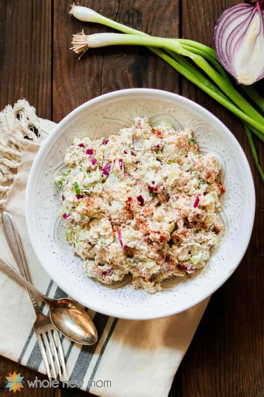 Cauliflower potato salad in a white dish