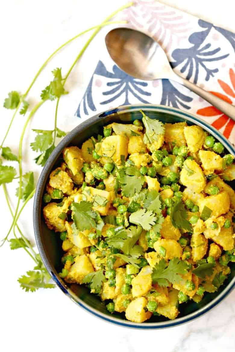 Curried potato salad in a bowl with cilantro
