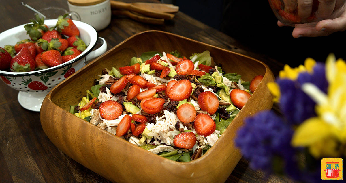 Strawberry chicken salad with strawberries in a bowl