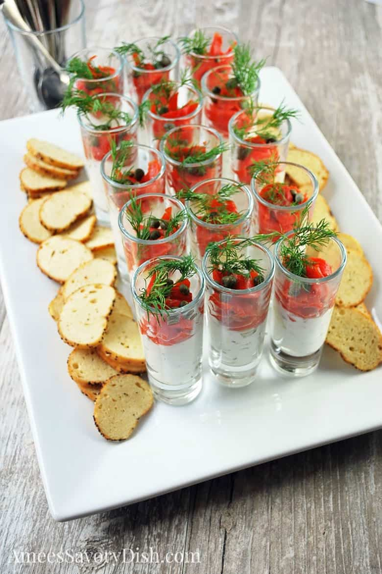 Smoked Salmon Shooters in glasses topped with dill served from Amee's Savory Dish