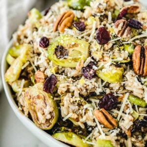 Close up of roasted brussels sprouts salad in a white bowl