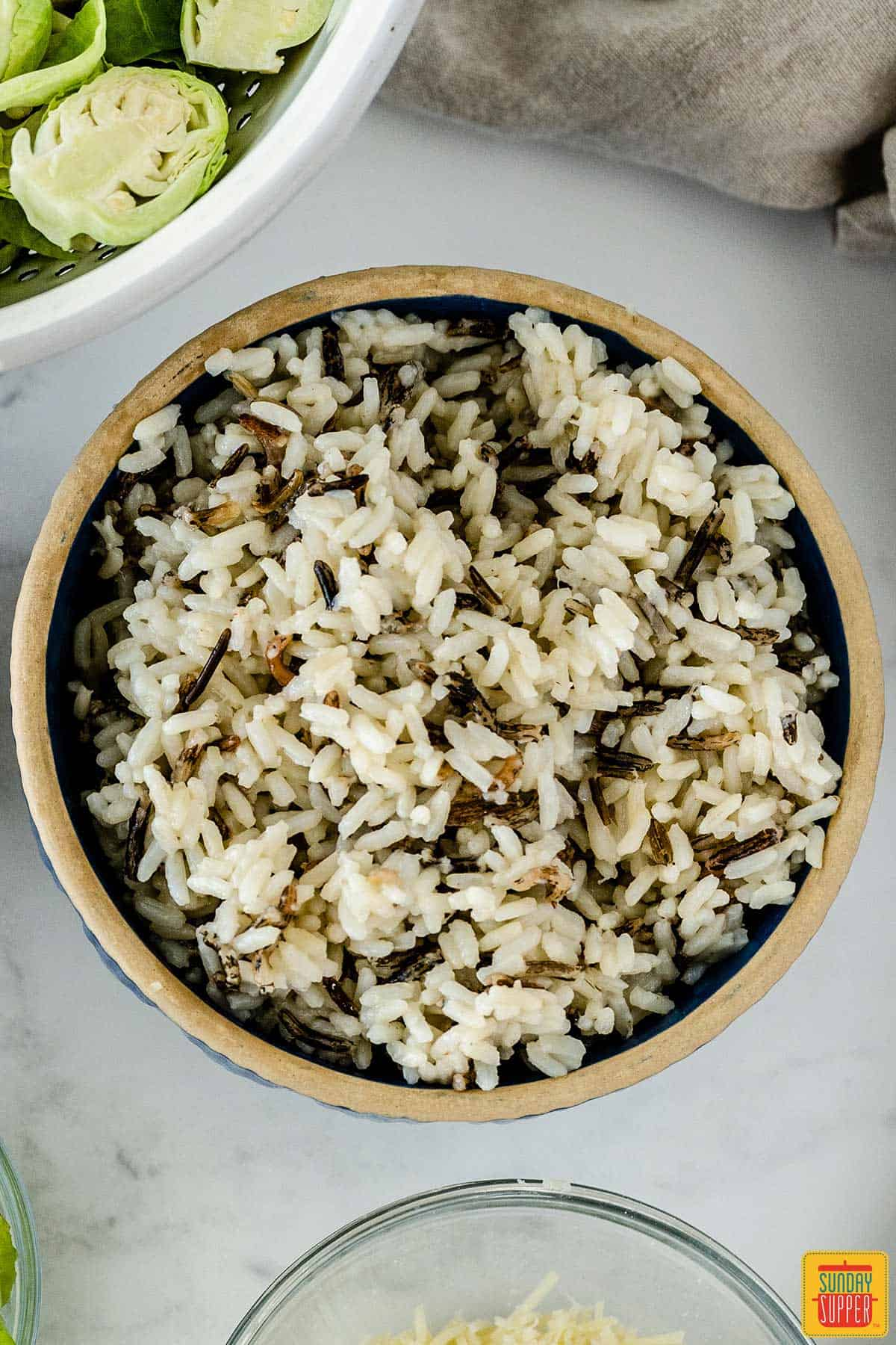 Cooked wild rice up close in a bowl