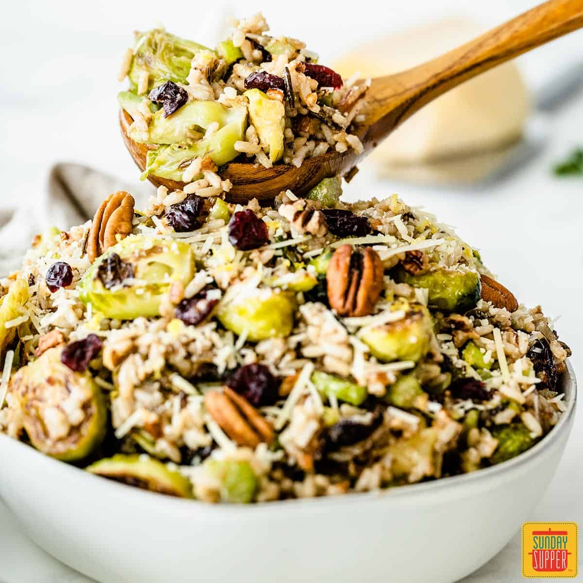 A wooden spoonful of roasted brussels sprouts salad