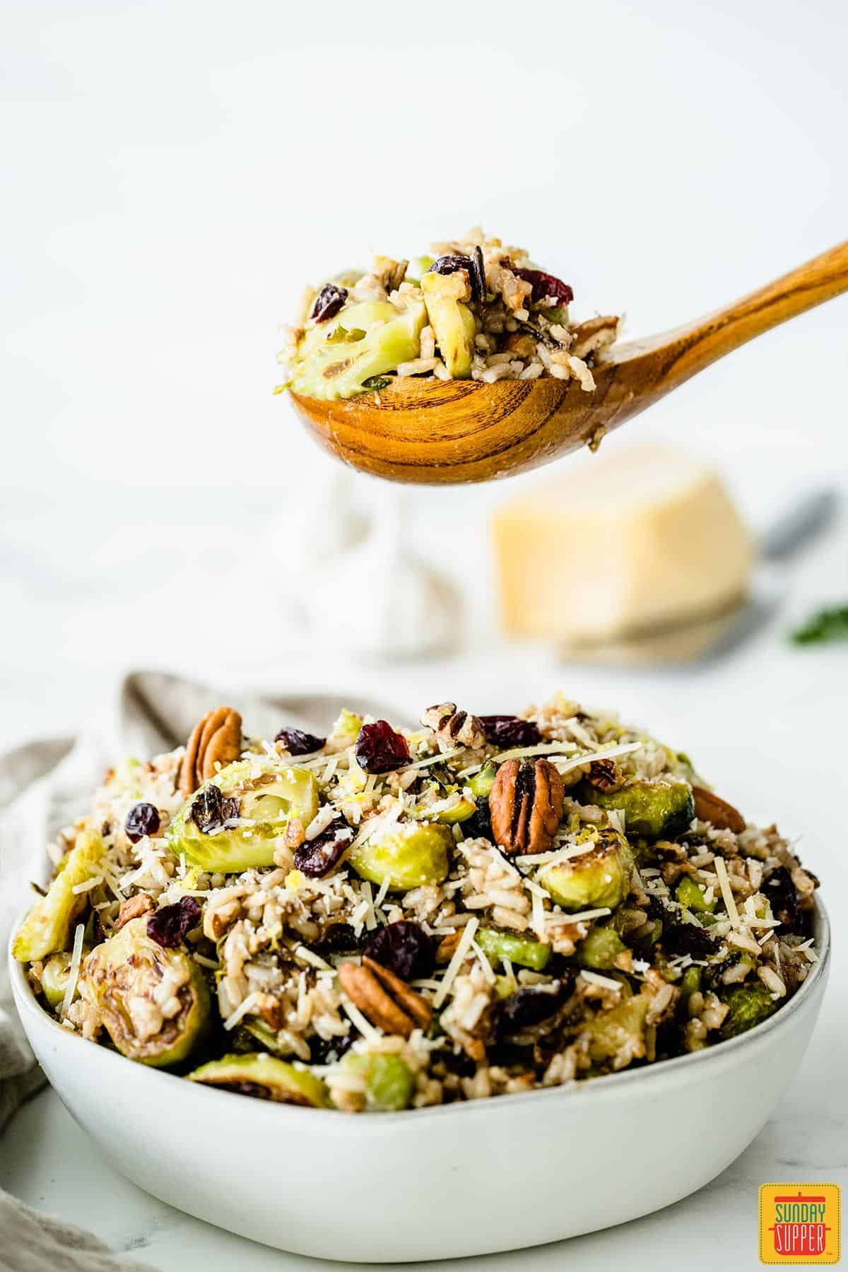 A spoonful of wild rice salad with brussels sprouts