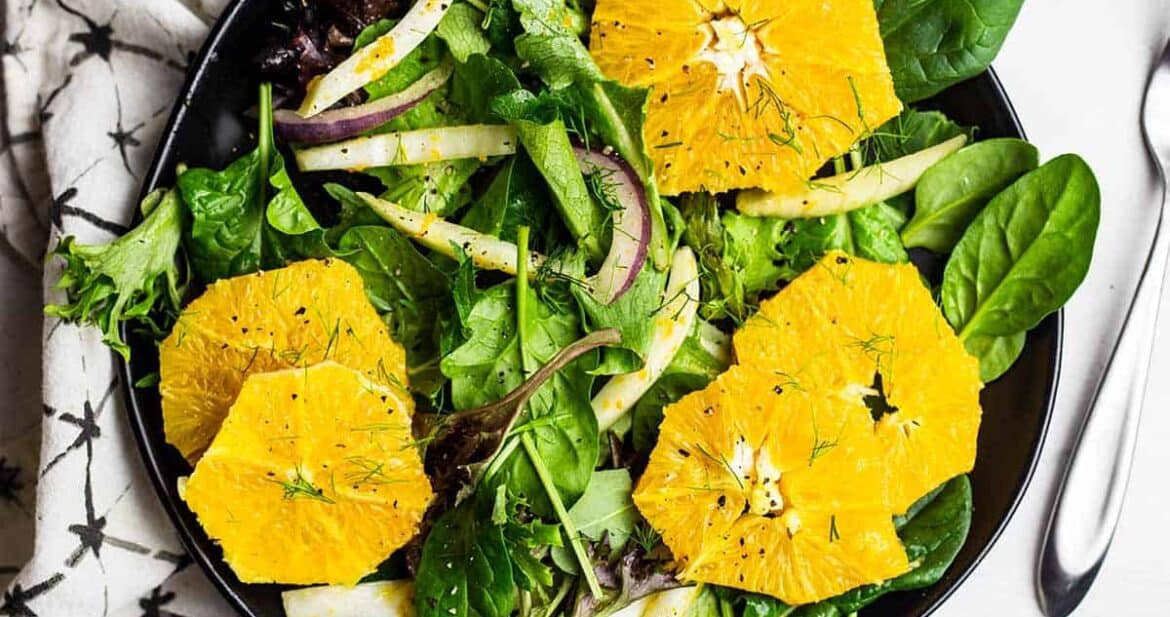 Orange and fennel salad on a black plate