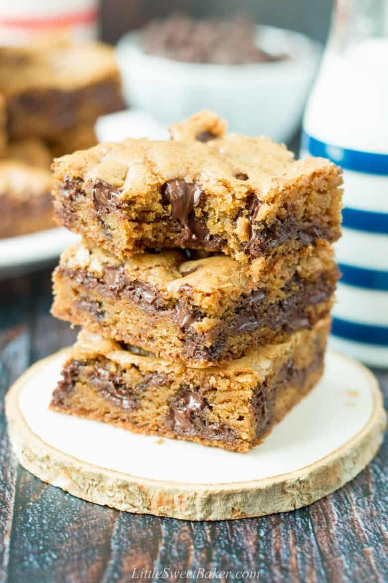 Chocolate chip cookie bars stacked high by Little Sweet Baker