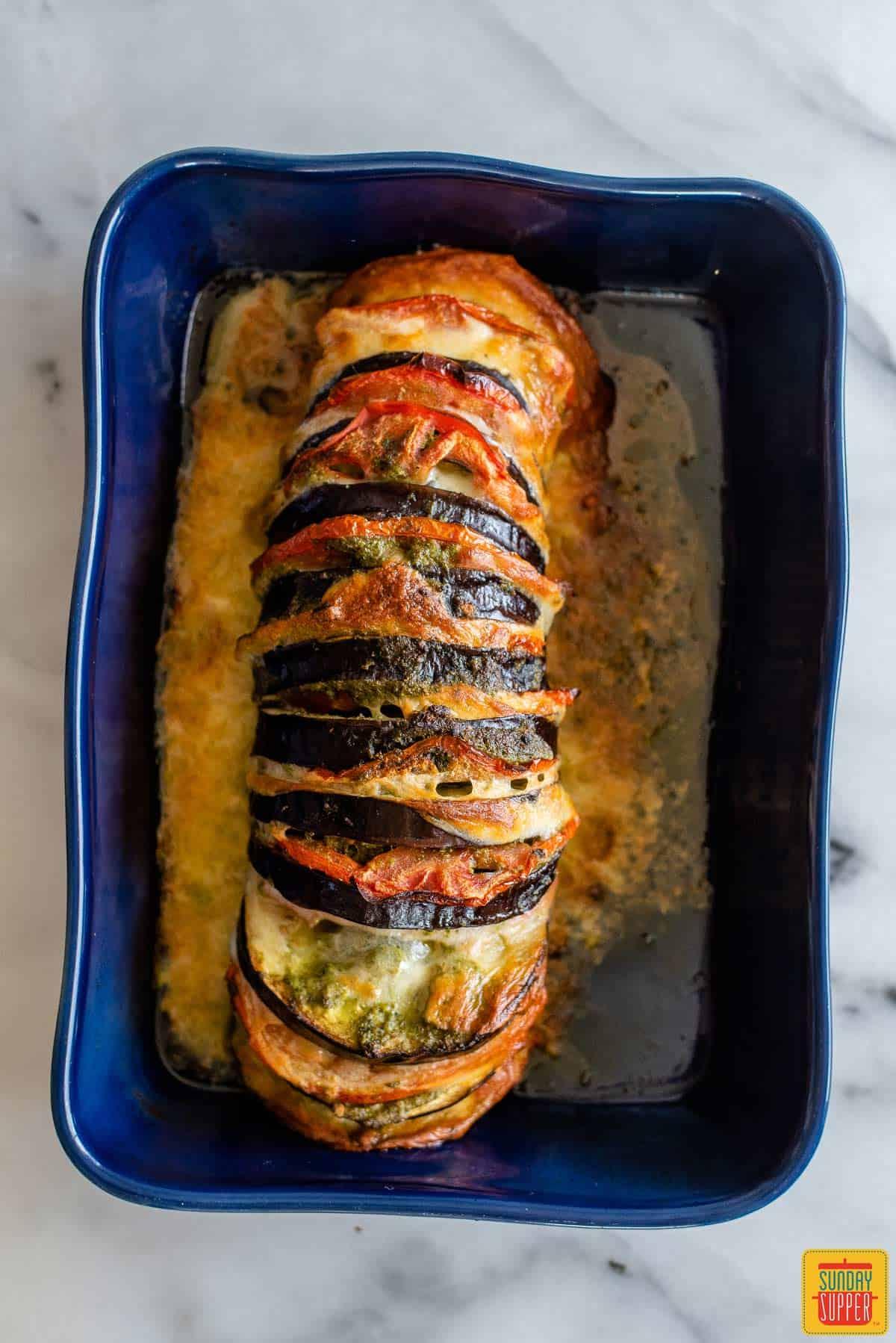 Caprese roasted eggplant on a blue baking dish