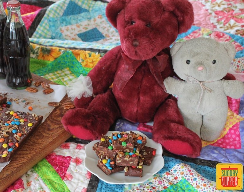 2-minute quick fudge on a white plate next to two teddy bears
