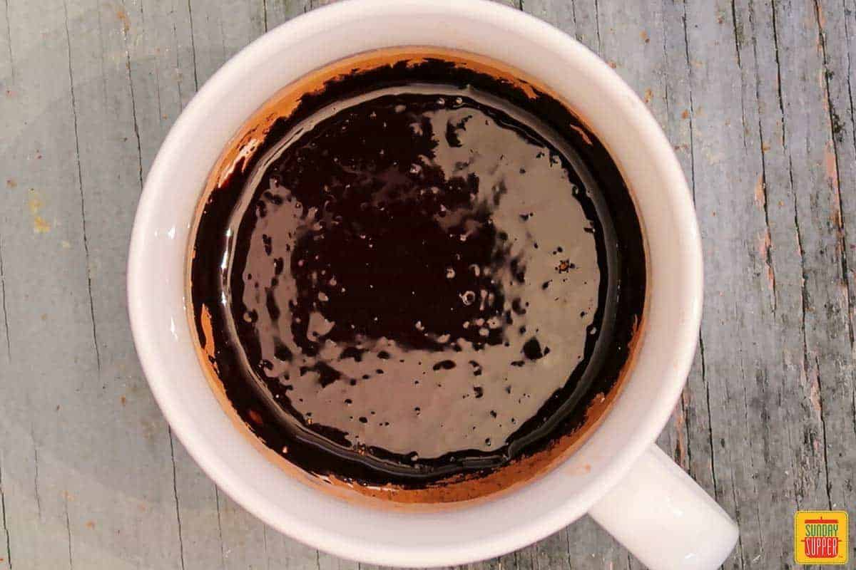 Mixed cocoa powder and oil in a mug
