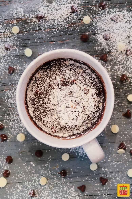 Brownie mug cake with powdered sugar on top