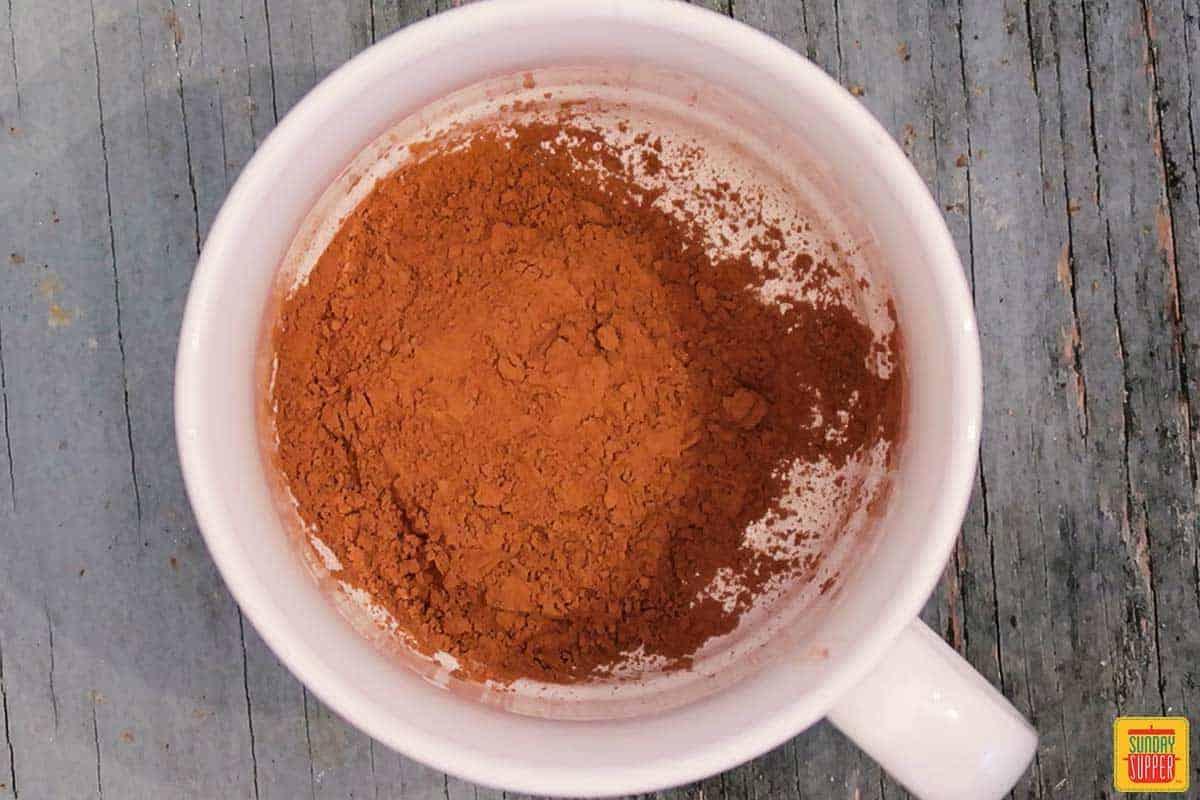 Cocoa powder in a white mug