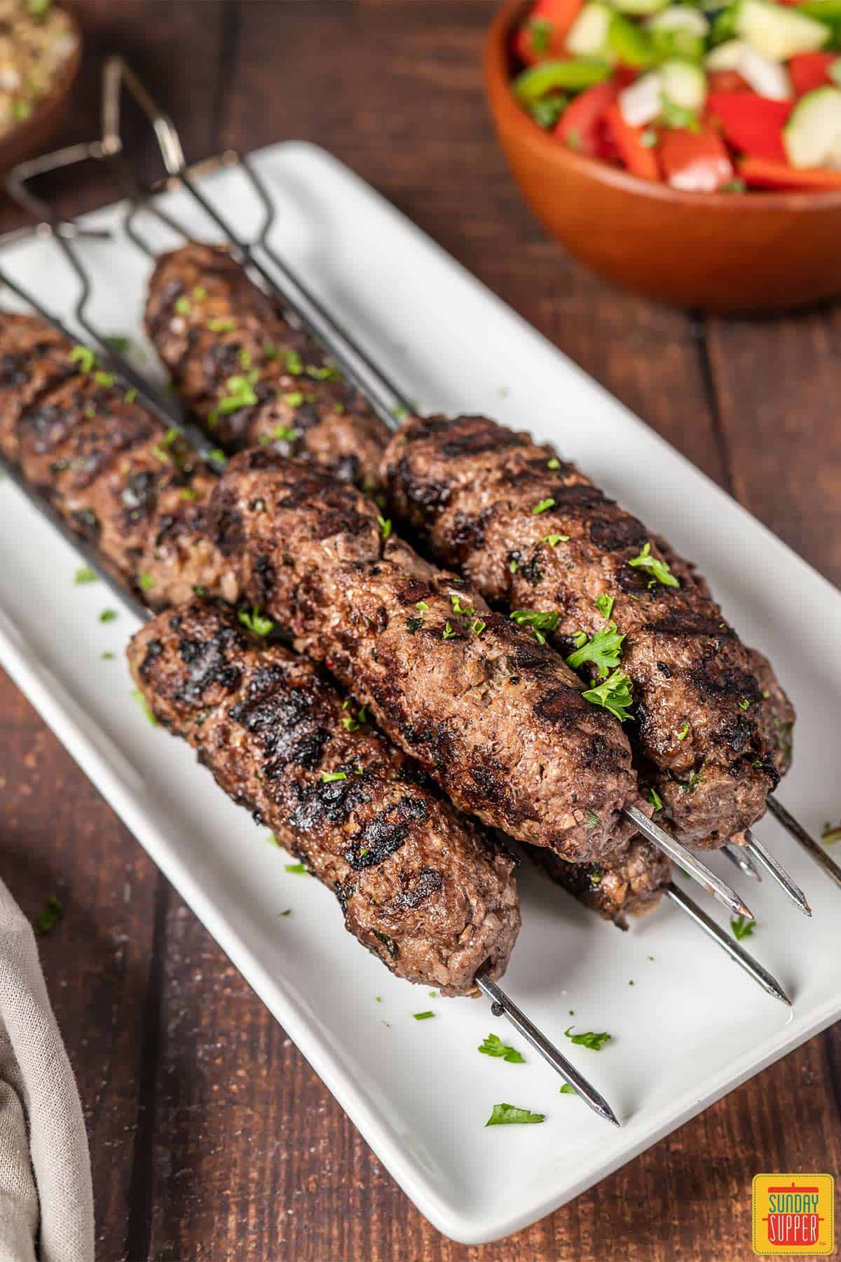 Lebanese kebabs on a white platter with no sauce