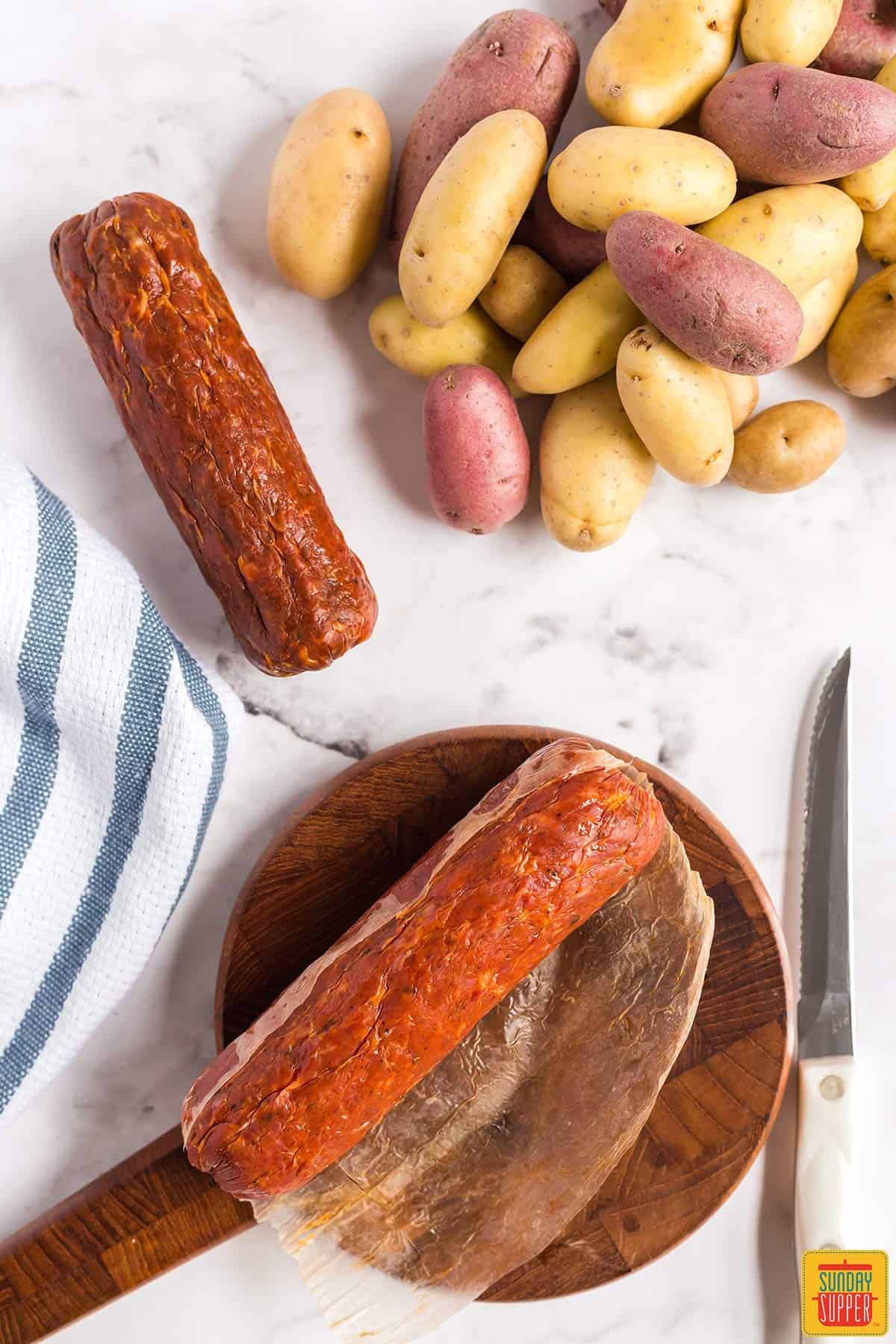 Removing the skin from Portuguese chorizo