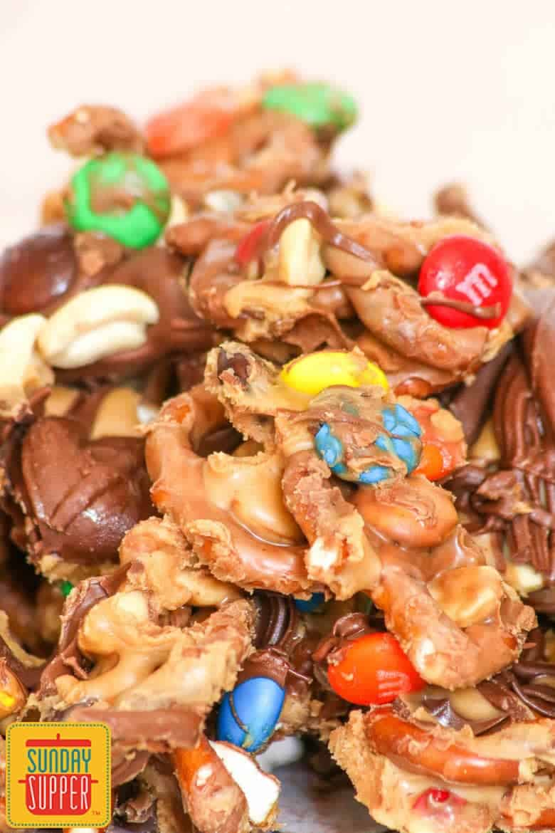 Quick chocolate peanut butter pretzel mix with chocolate candies and peanut butter slathered pretzels