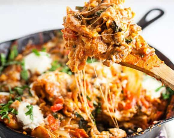 Cowboy Cooking and Cast Iron Care: image of a cheesy lasagna made in a cast iron skillet