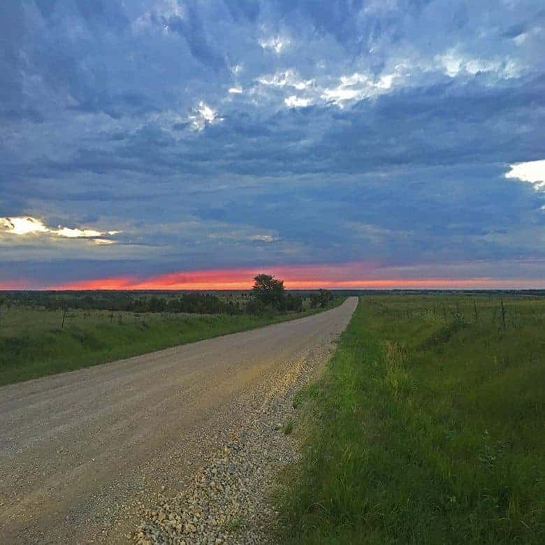 Sunset over the ranch on the dirt road leading home.