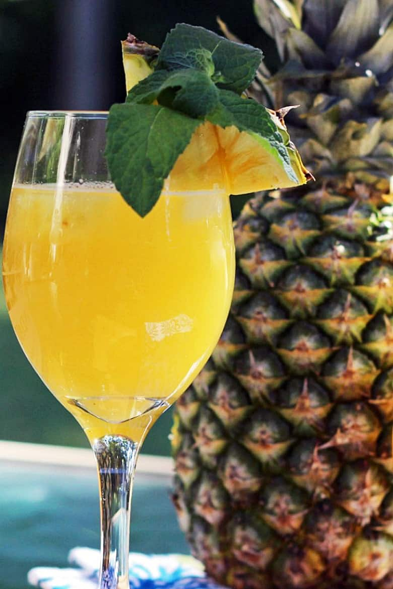 Simple Mixed Drinks - Pineapple Jalapeno Wine Spritzer with a pineapple slice on the rim of the glass