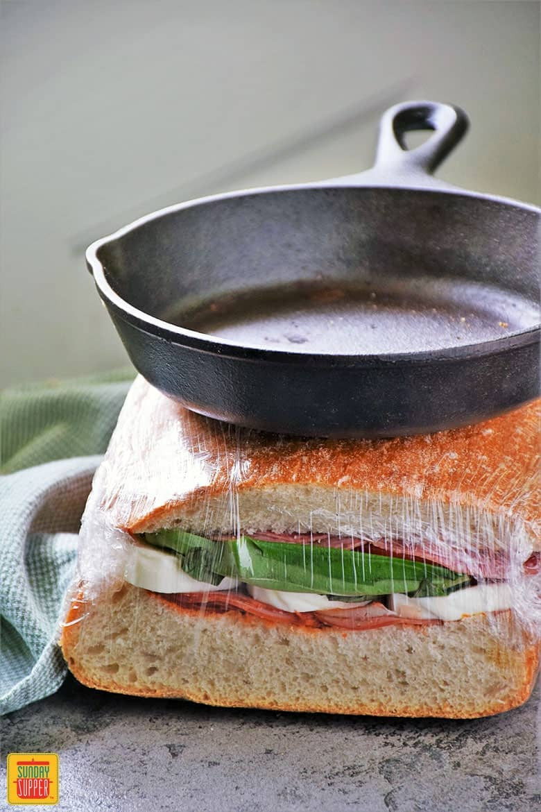 Wrap and gently press with skillet the Italian Pressed Sandwich