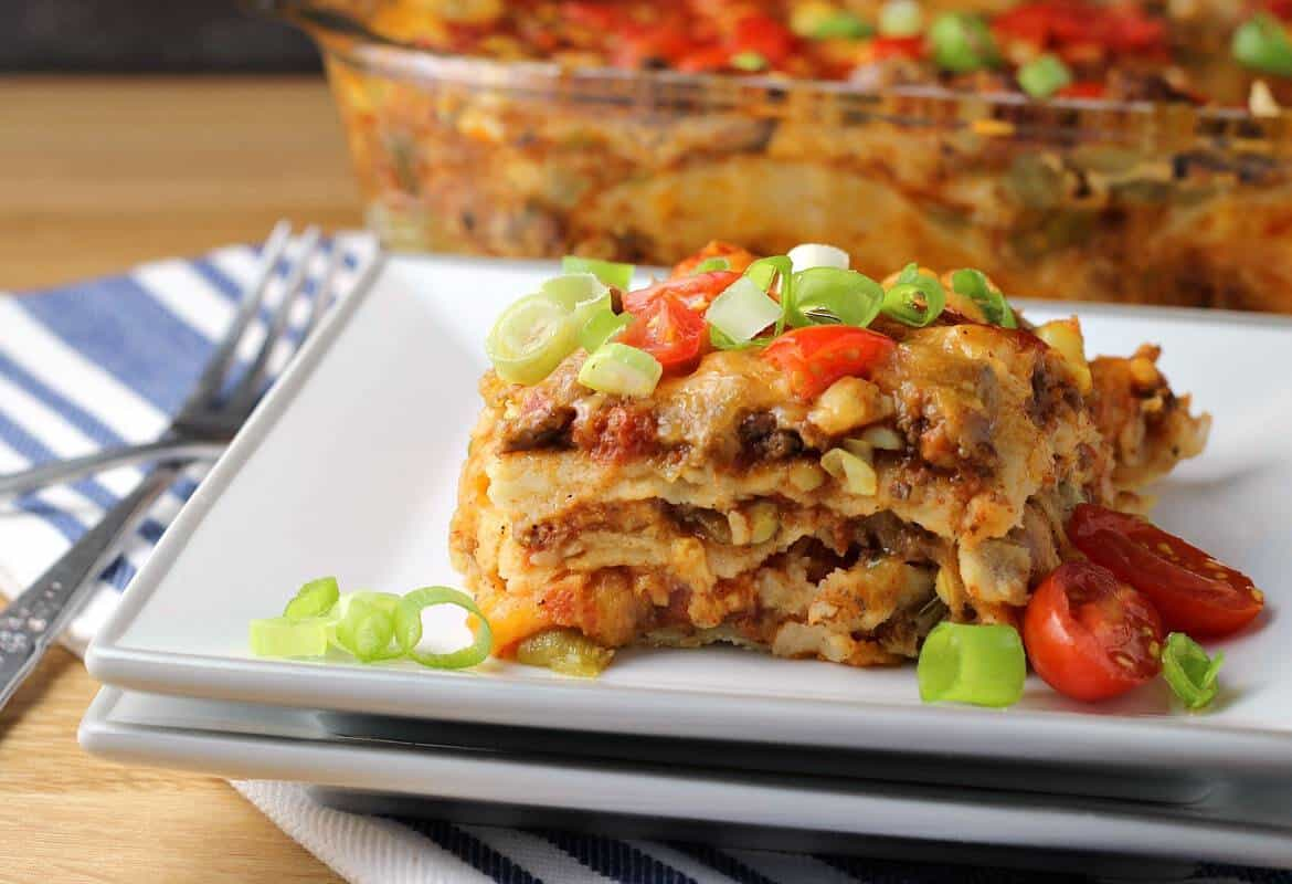 Mexican Lasagna with Tortillas - a serving of taco lasagna on a white plate