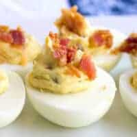 Close up of bacon jalapeno deviled eggs with cream cheese