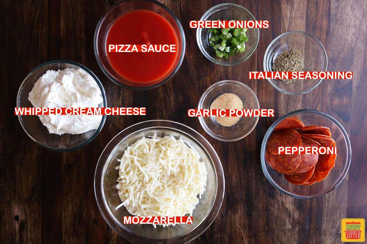 pizza dip ingredients labeled on a table