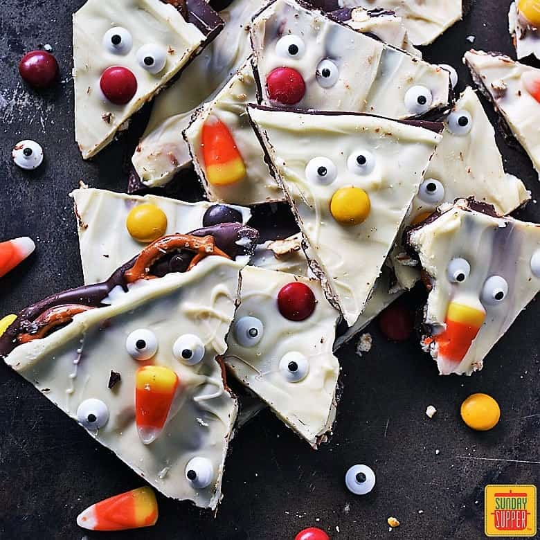 Halloween Chocolate Bark pieces on a dark background