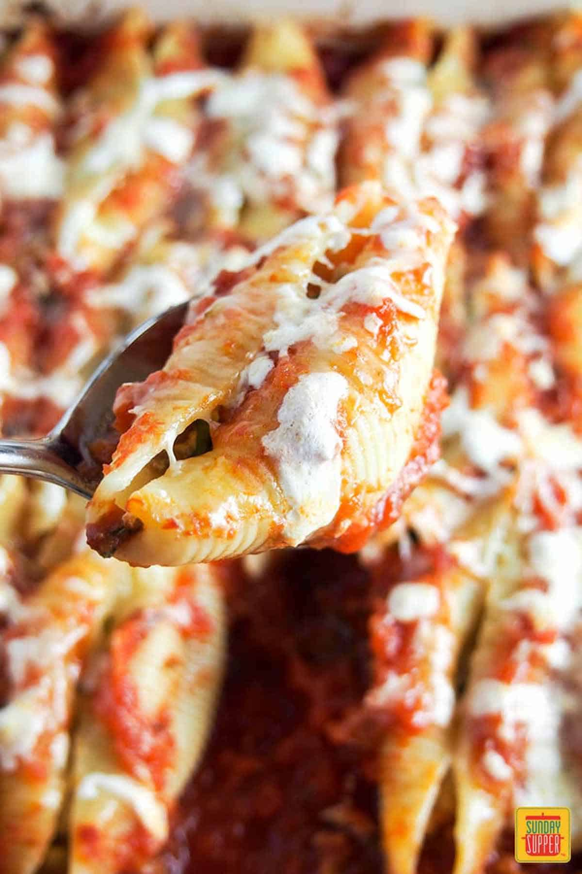 Pulled pork stuffed shells in the baking dish