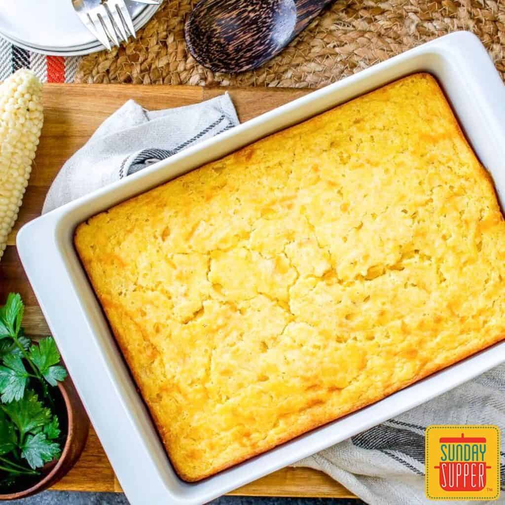 Creamed corn casserole in a white baking dish