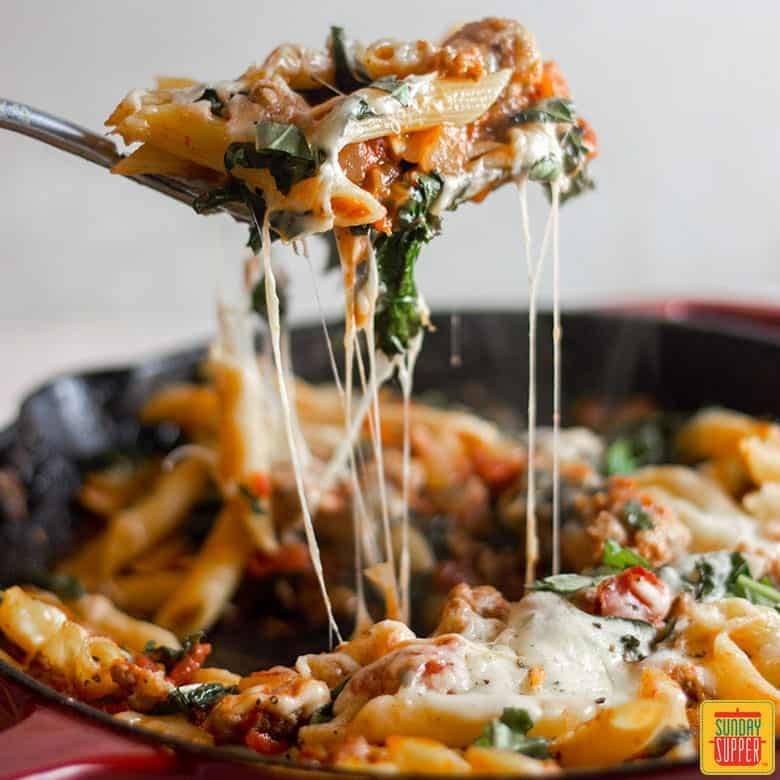 Forkful of Italian sausage and kale pasta