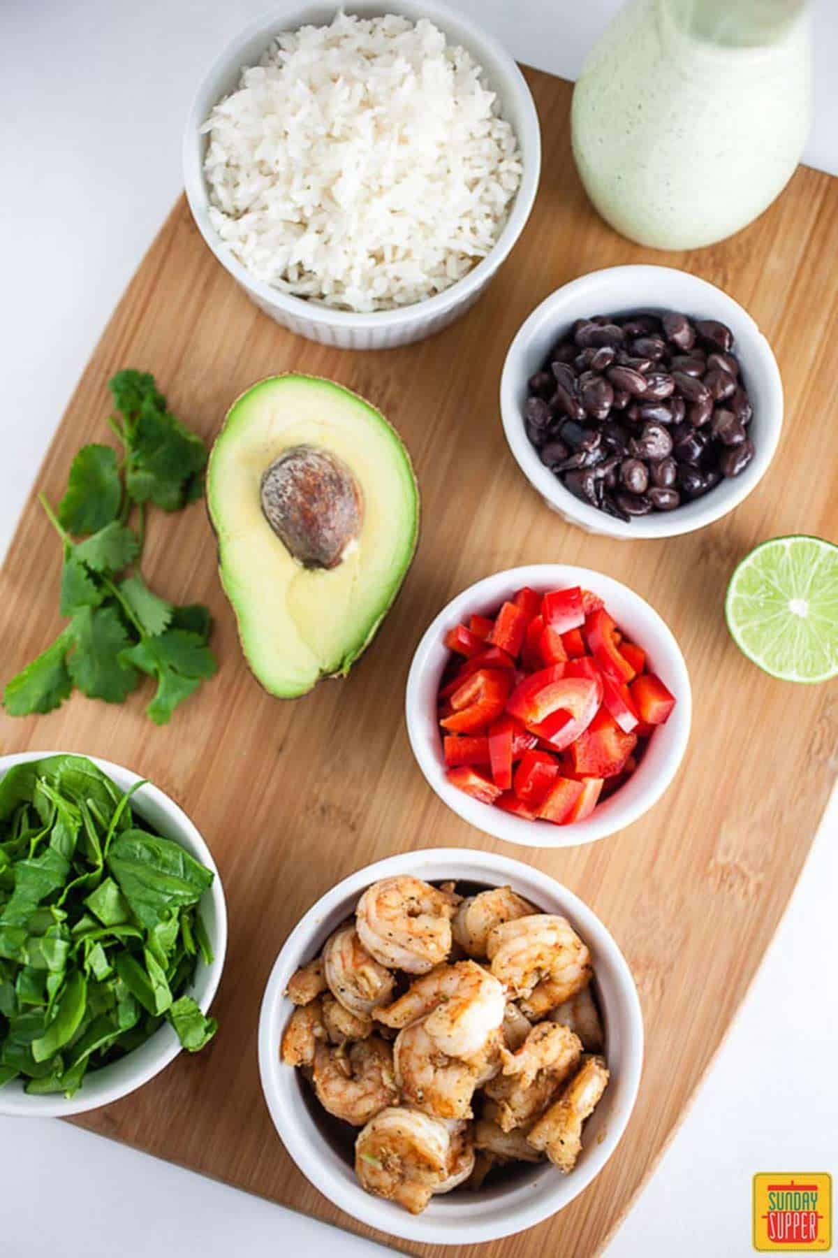 Ingredients for Shrimp Mexican Rice Bowl on a cutting board