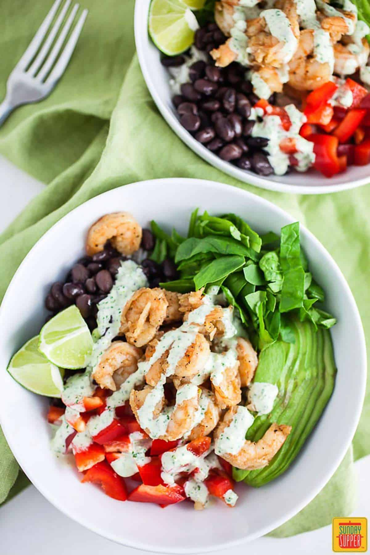 Two bowls of mexican shrimp rice bowl