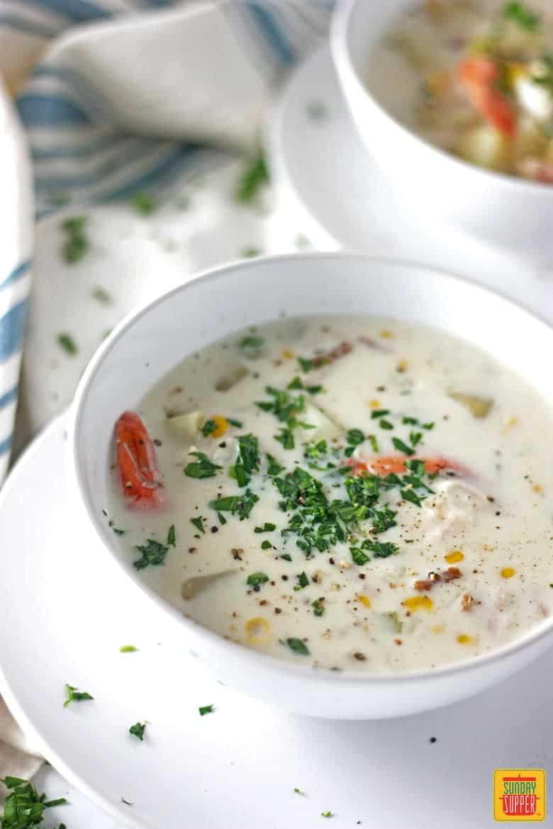 New England Seafood Chowder recipe garnished with parsley and ready to eat