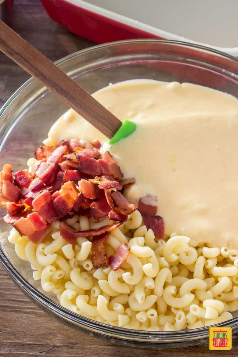 Elbow macaroni noodles, homemade cheese sauce and bacon get mixed together to make this amazing bacon macaroni and cheese