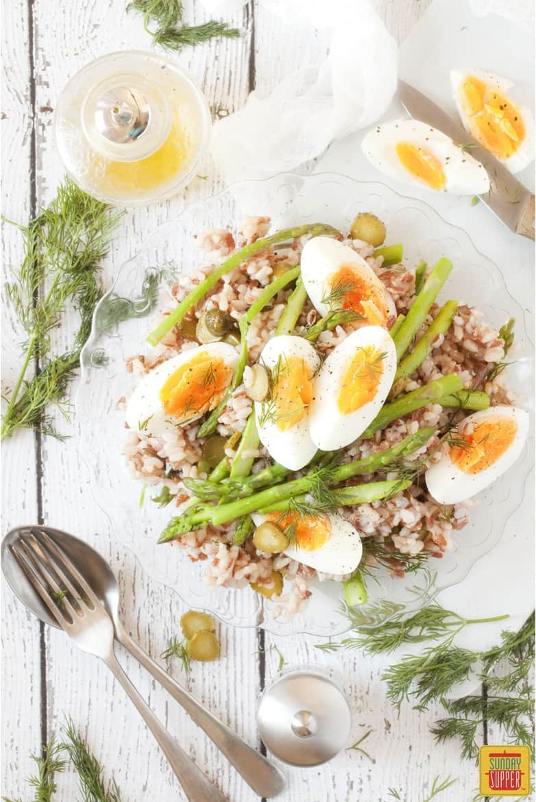 Asparagus Salad with Rice topped with boiled eggs and served with vinaigrette