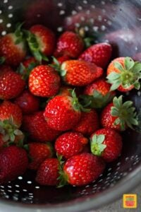 Strawberries washed in a colander