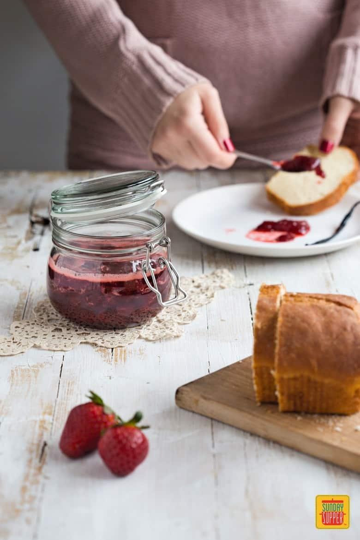 Strawberry Vanilla jam, slices of bread, fresh strawberries