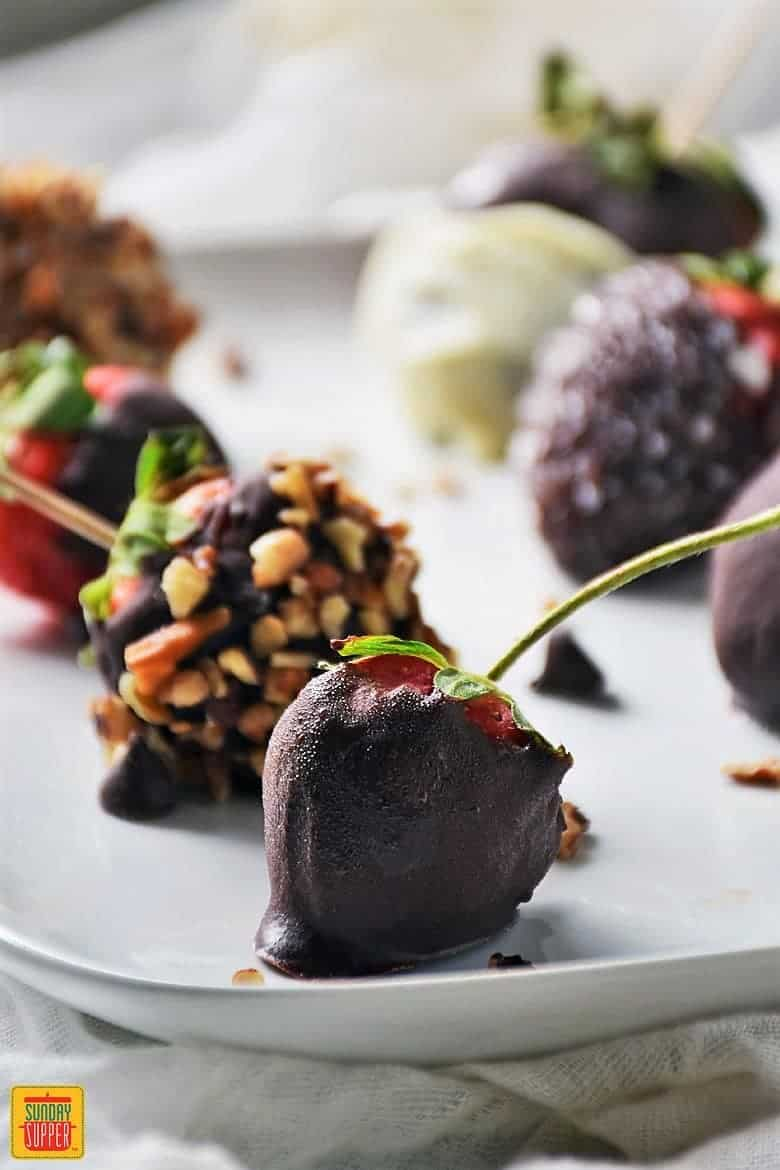 Chocolate Ganache Covered Strawberries on a white serving tray