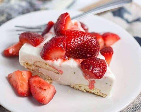 Slice of Carlota de Limon with fresh strawberries for fresh strawberry desserts