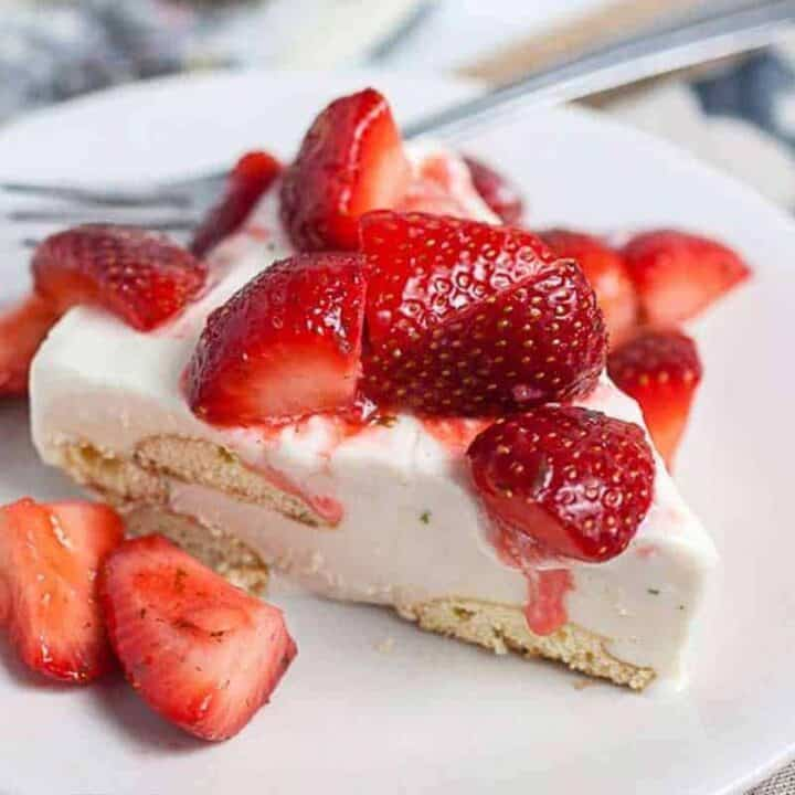 Slice of Carlota de Limon with fresh strawberries for fresh strawberry desserts