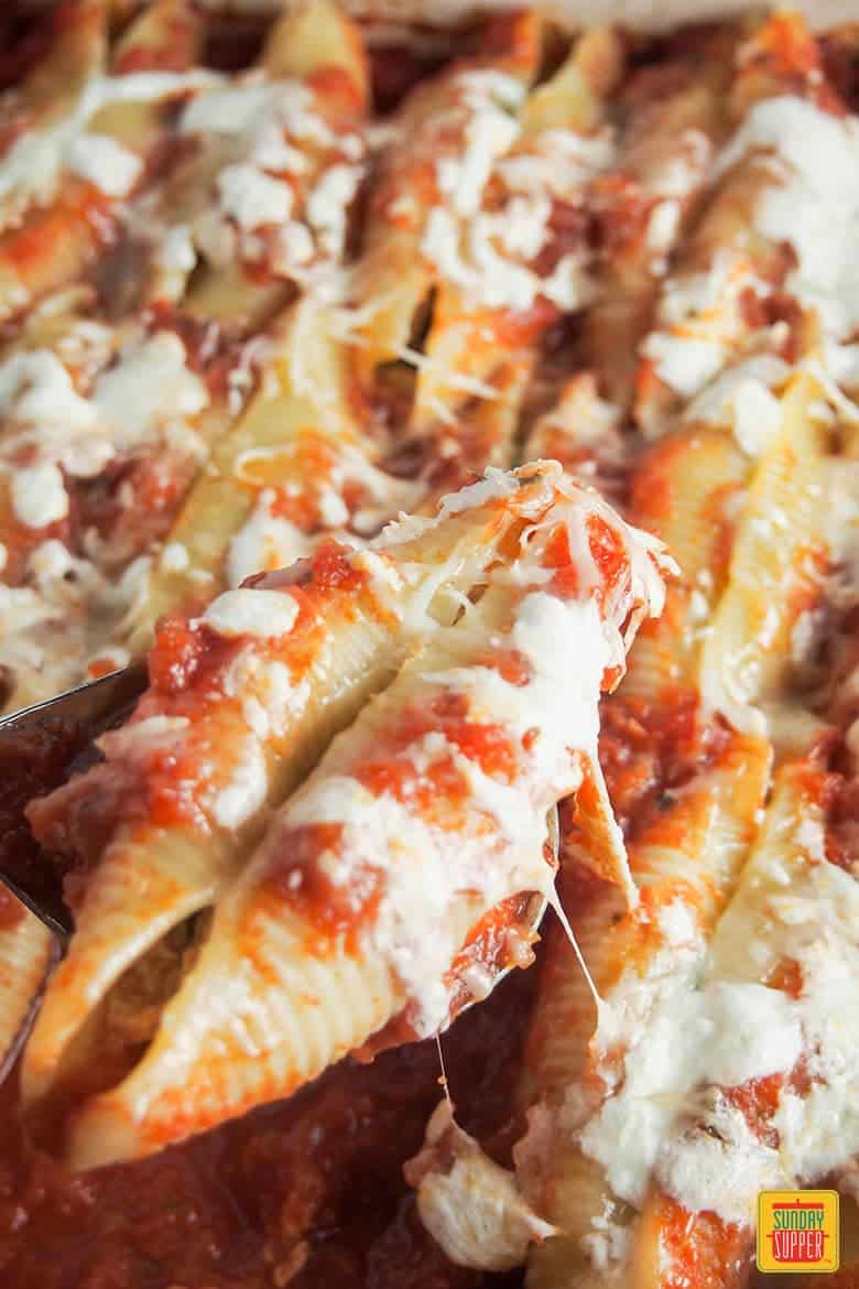 Pulled Pork Stuffed Shells smothered in melted cheese and ready to eat