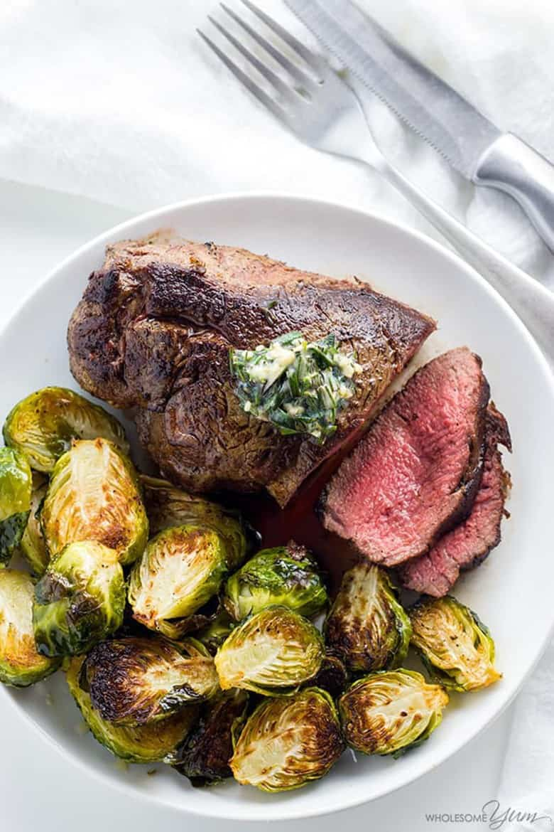 Best Filet Mignon Recipe with Garlic Herb Butter served with brussels sprouts