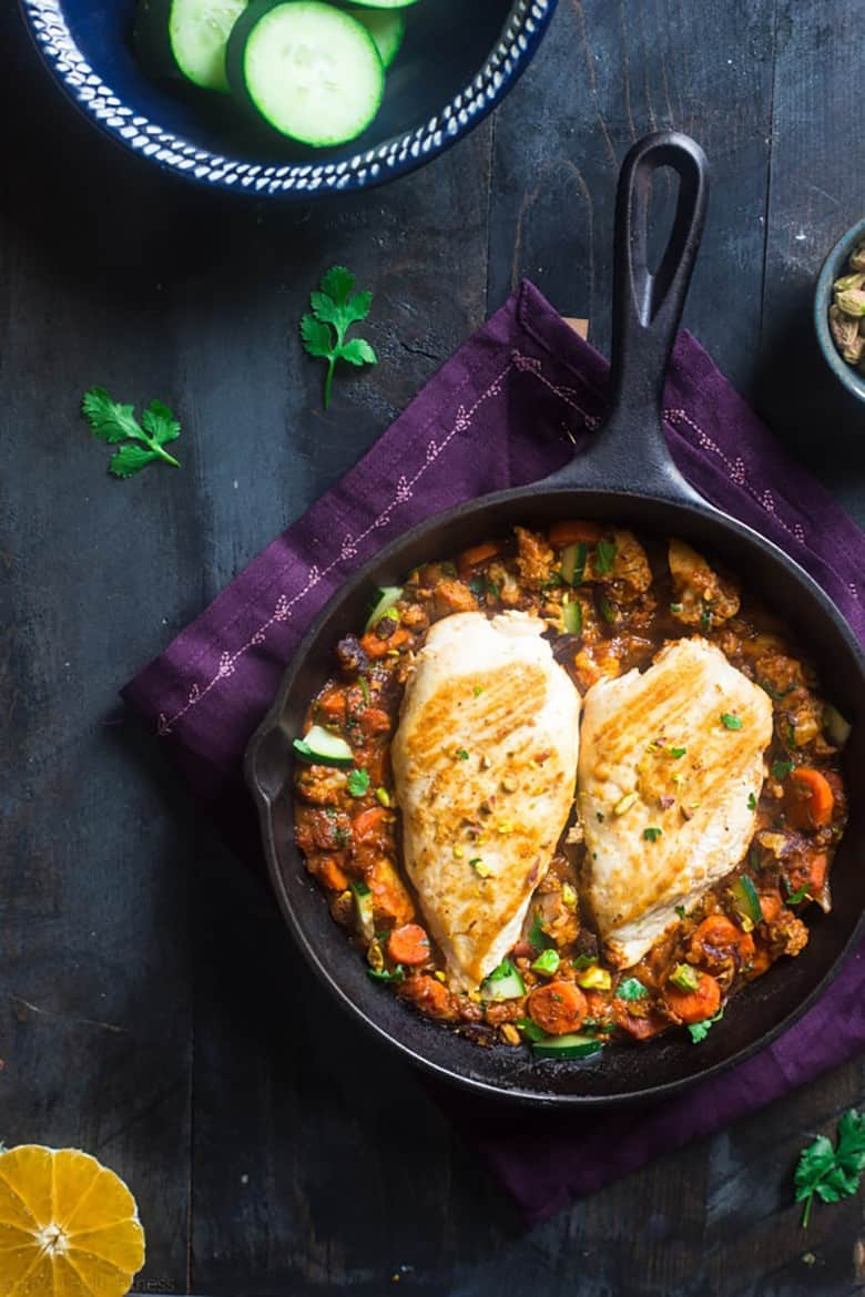 Moroccan Chicken Skillet served in a skillet with fresh vegetables