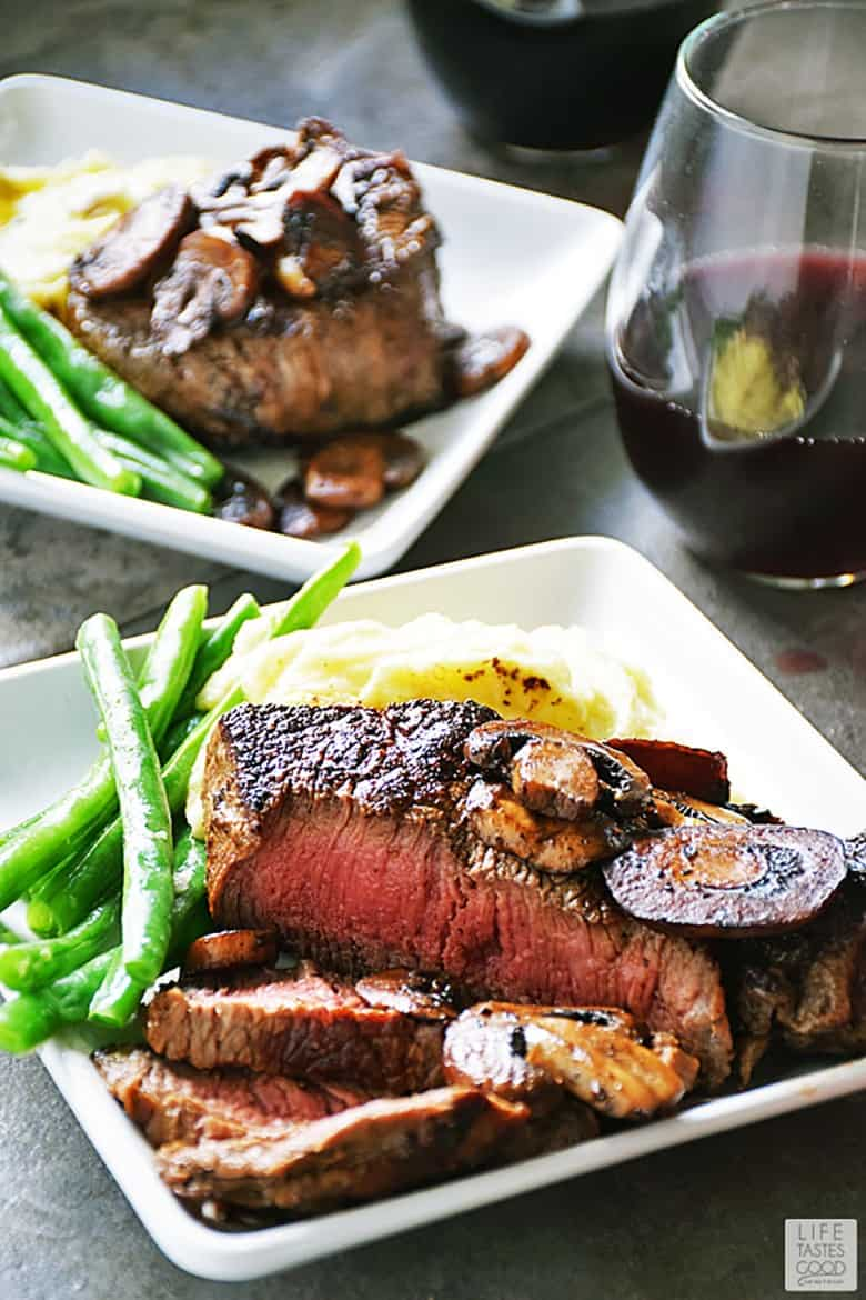 Pan Seared Sirloin Steak Dinner for Two served on square white plates with fresh green beans