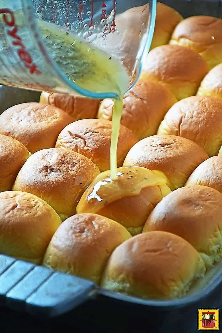 Pouring the buttery mustard glaze on the Turkey Sliders Recipe