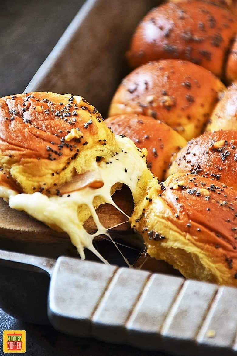 Serving a cheesy baked turkey slider right from the pan