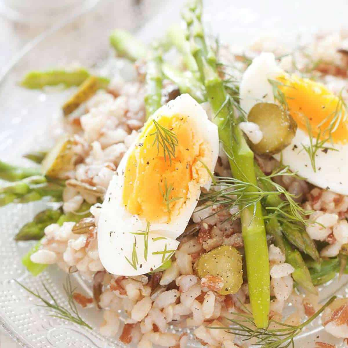 Close up of asparagus rice salad with hard boiled eggs