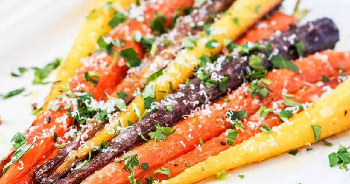Garlic parmesan roasted carrots on a white plate