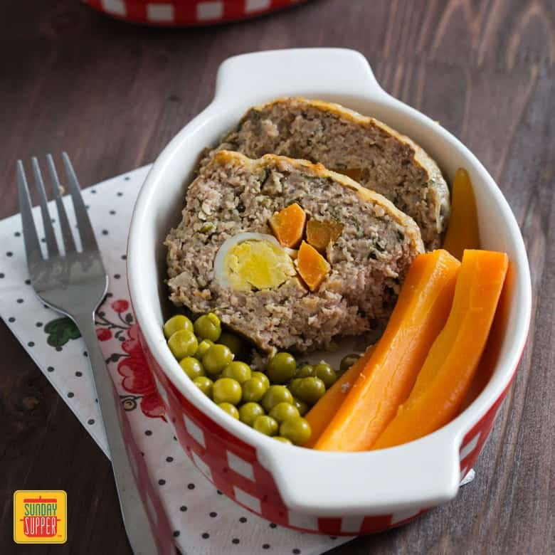 Stuffed Beef Roll Meal Prep Recipe with green peas and carrots in individual containers